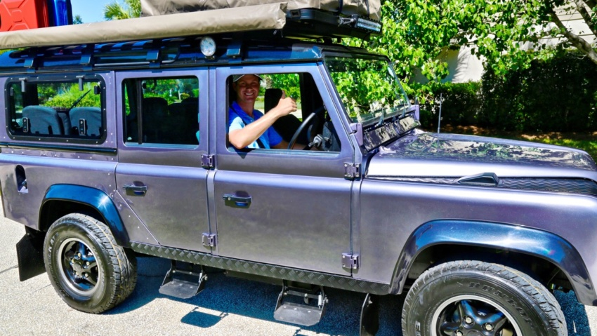 golfer harris english in a land rover defender